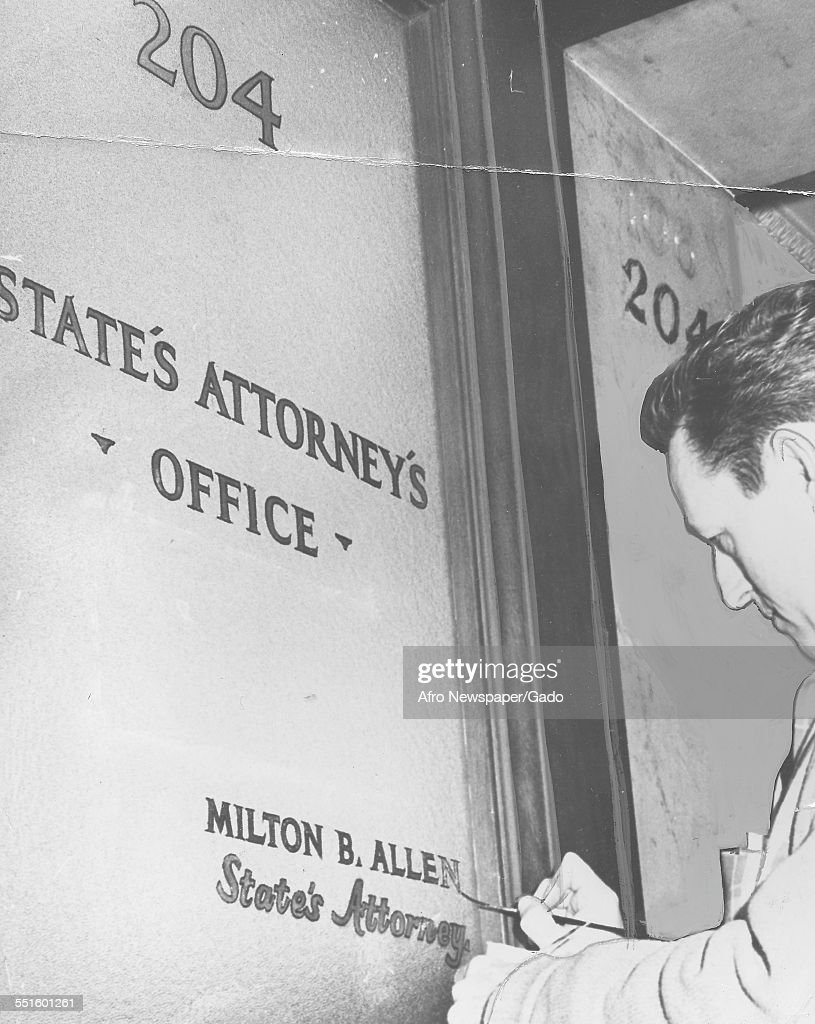 The new name being painted on the office door of the Chief prosecutor States Attorney Milton Allan painted by Will Manning Baltimore Maryland 1970