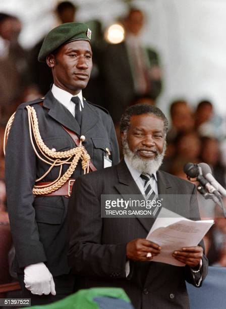 The new Namibian President Sam Nujoma addresses the officials 21 March 1990 in Windhoek at the beginning of Namibia's independence celebrations which...
