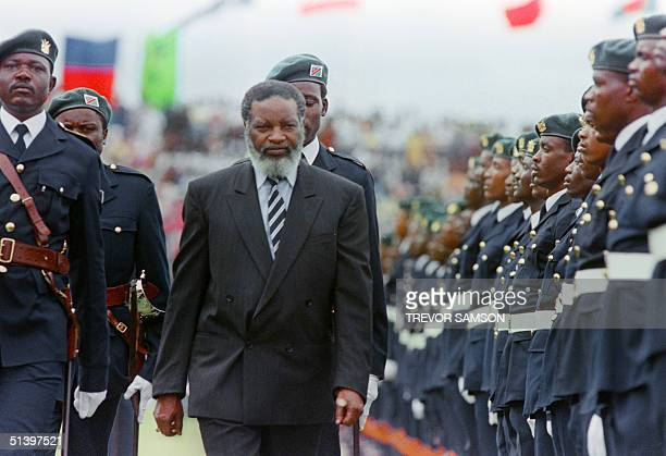 The new Namibian President Sam Nujoma reviews a guard of honour 21 March 1990 in Windhoek at the beginning of Namibia's independence celebrations...