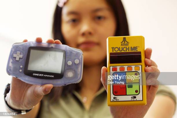The new Nintendo Gameboy Advance left and one of the earliest handheld games the Atari Touch Me are displayed side by side June 21 2001 in London The...