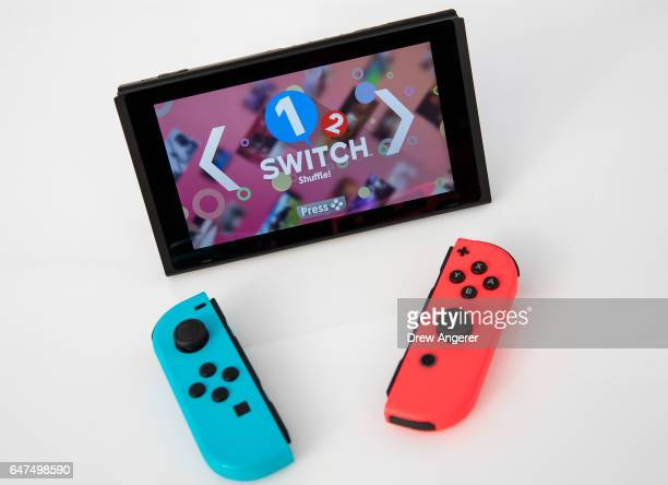 The new Nintendo Switch game console is displayed at a popup Nintendo venue in Madison Square Park March 3 2017 in New York City The Nintendo Switch...