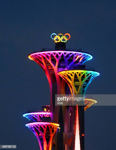 The new Olympic rings symbol on the Beijing Olympic Tower lights up for the first time on June 12 2016 in Beijing China The 18meter high rotating...