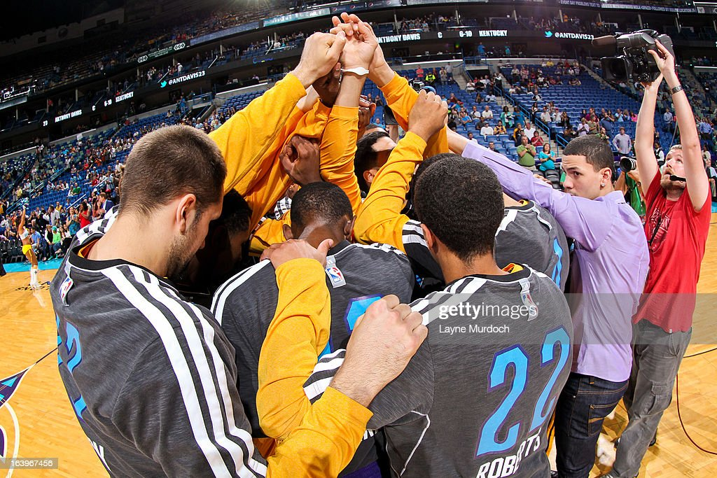 The New Orleans Hornets huddle up before playing against the Golden State Warriors on March 18, 2013 at the New Orleans Arena in New Orleans, Louisiana.