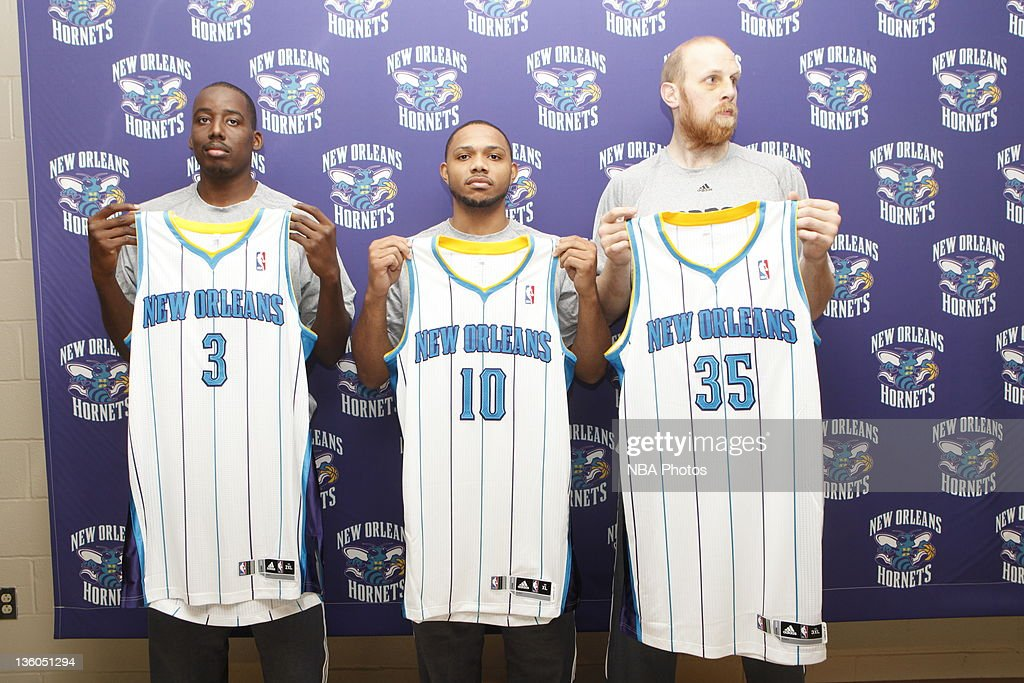The New Orleans Hornets introduce forward (L-R) <a gi-track='captionPersonalityLinkClicked' href=/galleries/search?phrase=Al-Farouq+Aminu&family=editorial&specificpeople=5042446 ng-click='$event.stopPropagation()'>Al-Farouq Aminu</a>, guard <a gi-track='captionPersonalityLinkClicked' href=/galleries/search?phrase=Eric+Gordon+-+Basketball+Player&family=editorial&specificpeople=4212733 ng-click='$event.stopPropagation()'>Eric Gordon</a> and center <a gi-track='captionPersonalityLinkClicked' href=/galleries/search?phrase=Chris+Kaman&family=editorial&specificpeople=201661 ng-click='$event.stopPropagation()'>Chris Kaman</a> on December 17, 2011 at the New Orleans Arena in New Orleans, Louisiana.