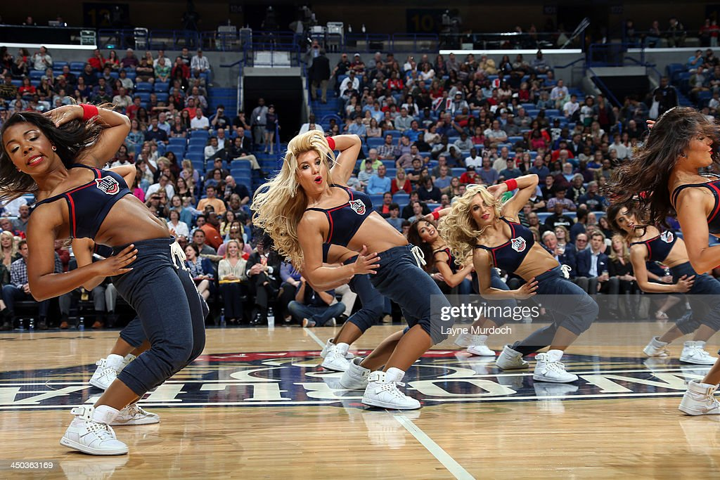 The New Orleans Pelicans dance team performs during the game against the Philadelphia 76ers on November 16, 2013 at the New Orleans Arena in New Orleans, Louisiana.