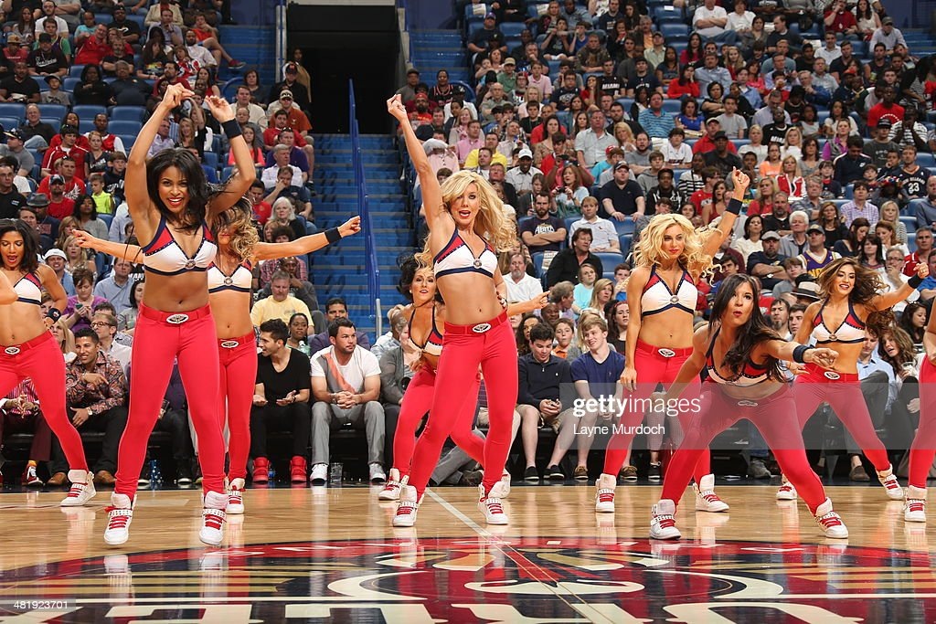 The New Orleans Pelicans dance team performs during the game against the Miami Heat on March 22, 2014 at the Smoothie King Center in New Orleans, Louisiana.