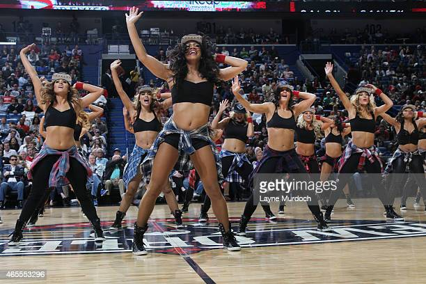 The New Orleans Pelicans dancers perform during the game against the Memphis Grizzlies on March 7 2015 at Smoothie King Center in New Orleans...