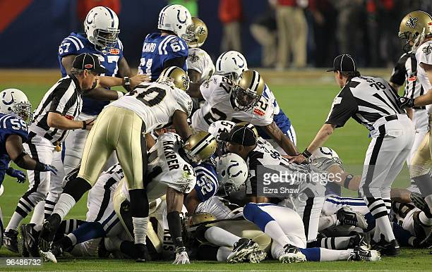The New Orleans Saints and Indianapolis Colts fight for a loose ball after a onside kick to start the second half with during Super Bowl XLIV on...