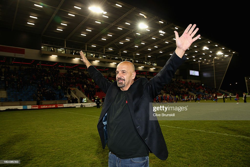 The new owner of Salford City Reds Dr Marwan Koukash parades around the pitch in for the fans prior to the Super League match between Salford City Reds and Wigan Warriors at Salford City Stadium on February 1, 2013 in Salford, England.