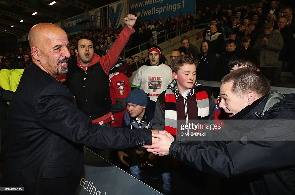 The new owner of Salford City Reds Dr Marwan Koukash shakes hands with the fans prior to the Super League match between Salford City Reds and Wigan Warriors at Salford City Stadium on February 1, 2013 in Salford, England.