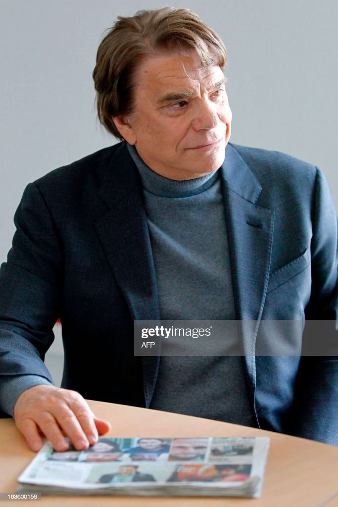 The new owner of the Nice Matin press group Bernard Tapie listens to journalists after meeting the group's employees on March 13, 2013 at the group's printing house in Bastia, Corsica.