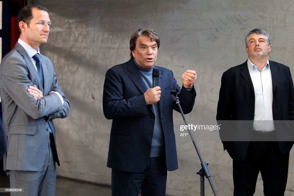 The new owner of the Nice Matin press group Bernard Tapie (C) talks to the group's employees on March 13, 2013 at the group's printing house in Bastia, Corsica, surrounded by Corse Matin newspaper chief editor Roger Antech (R) and member of the board of directors Frederic Touraille.