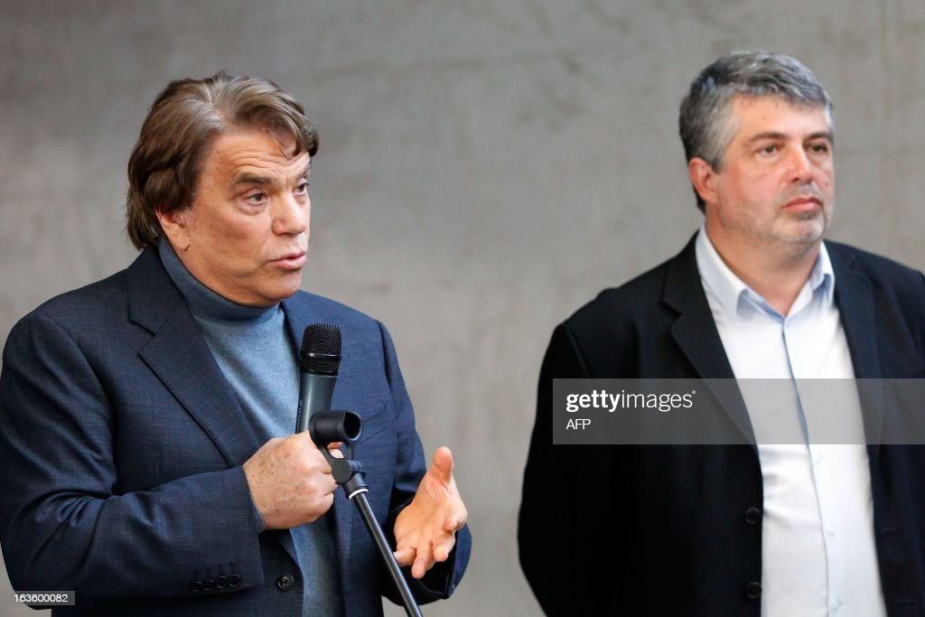 The new owner of the Nice Matin press group Bernard Tapie (L) talks to the group's employees on March 13, 2013 at the group's printing house in Bastia, Corsica, next to Corse Matin newspaper chief editor Roger Antech. AFP PHOTO / PASCAL POCHARD-CASABIANCA