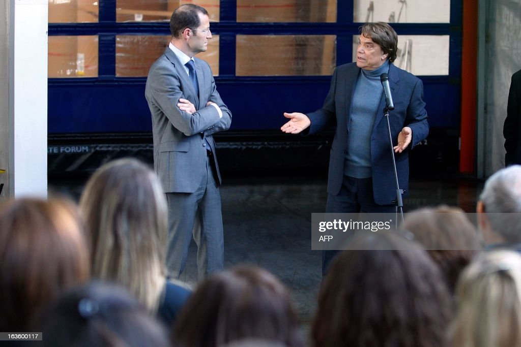 The new owner of the Nice Matin press group Bernard Tapie (R) talks to the group's employees on March 13, 2013 at the group's printing house in Bastia, Corsica, next to member of the board of directors Frederic Touraille. AFP PHOTO / PASCAL POCHARD-CASABIANCA