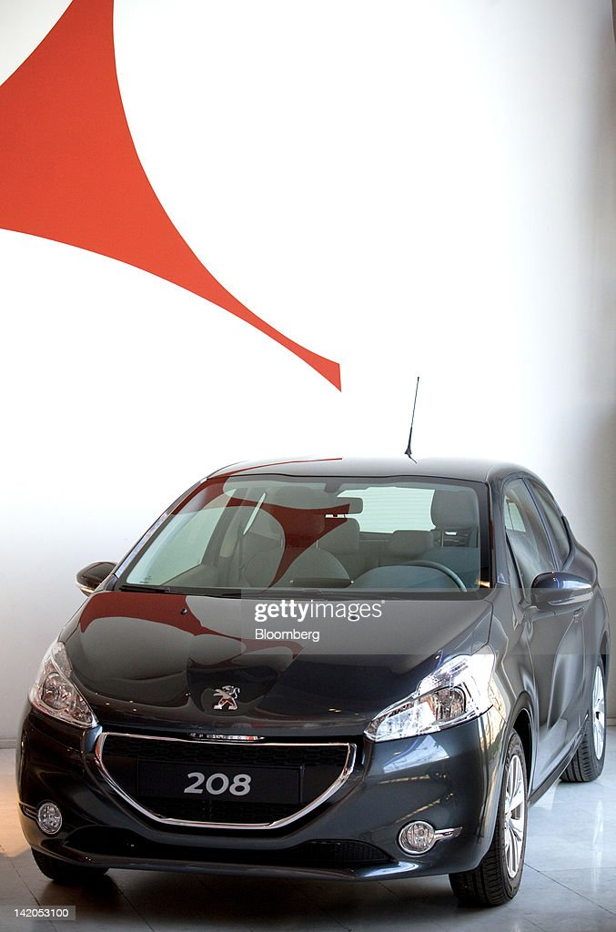 The new Peugeot 208 automobile, produced by PSA Peugeot Citroen SA, is seen on display at the company's headquarters in Paris, France, on Wednesday, March 28, 2012. PSA Peugeot Citroen SA, Europe's second-biggest carmaker, seeks leadership in the region's small-car segment with its new 208 model. Photographer: Balint Porneczi/Bloomberg via Getty Images