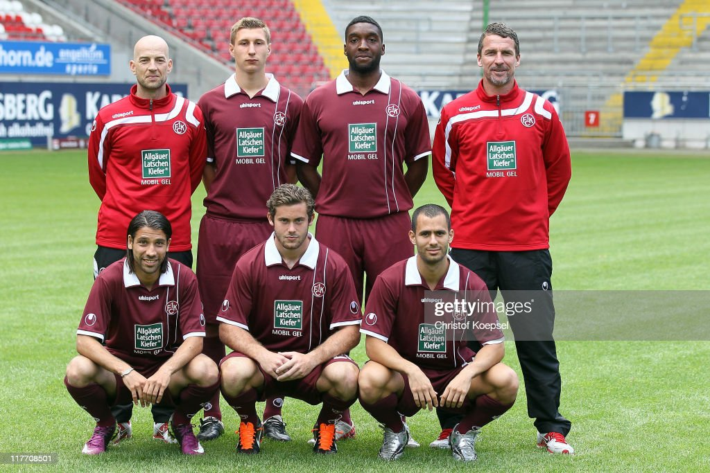 The new player of Kaiserslautern pose from (L-R) from the upper row with assistant coach Guenter Gorenzel, Julian Derstoff, <a gi-track='captionPersonalityLinkClicked' href=/galleries/search?phrase=Richard+Sukuta-Pasu&family=editorial&specificpeople=4159199 ng-click='$event.stopPropagation()'>Richard Sukuta-Pasu</a> and head coach marco Kurz. The front row starts (L-R) with Olcay Sahan, Steven Zellner and Gil Vermouth during the 1.FC Kaiserslautern Team Presentation at Fritz-Walter stadium on June 30, 2011 in Kaiserslautern, Germany.