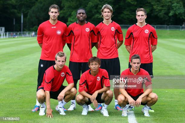 The new players with Kevin Trapp Olivier Occean Martin Lanig Bastian Oczipka Stefan Aigner Takashi Inui and Stefano Celozzi pose after the training...