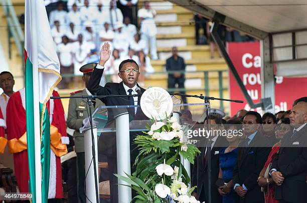 The new president of Madagascar Hery Rajaonarimampianina is sworn in during the inaugural ceremony for his presidency at the Mahamasina Stadium in...
