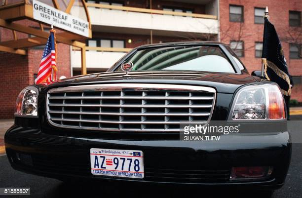The new presidential Cadillac limousine with 'Taxation Without Representation' license plates sits 15 January 2001 outside the Greenleaf Senior...
