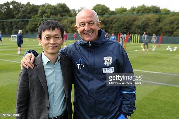 The new prospective owner of West Bromwich Albion Guochuan Lai from Yunyi Guokai Sports Development Limited meets Tony Pulis the head coach of West...