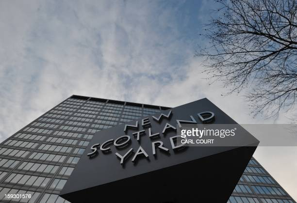 The New Scotland Yard sign stands outside the headquarters of the Metropolitan Police in central London on January 11 following the report by the...
