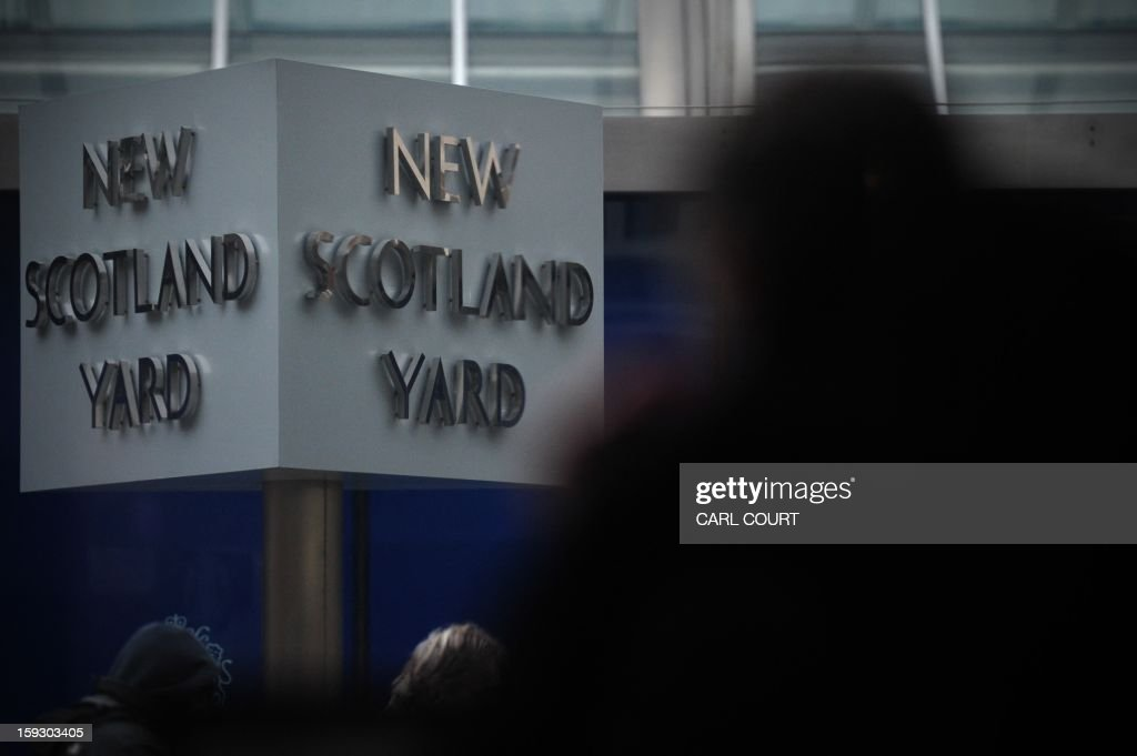 The New Scotland Yard sign stands outside the headquarters of the Metropolitan Police, in central London on January 11, 2013, following the report by the Metropolitan Police and NSPCC (National Society for the Prevention of Cruelty to Children) detailing 50 years of allegations of sexual abuse by former BBC presenter Jimmy Savile. British police said that late BBC star presenter Jimmy Savile was a predatory sex offender whose victims were as young as eight and who preyed on children and adults in hospitals and even a hospice. A report by police and child protection authorities found that the TV presenter, who was one of the biggest TV stars in Britain in the 1970s and 1980s, used his celebrity status to 'hide in plain sight'.
