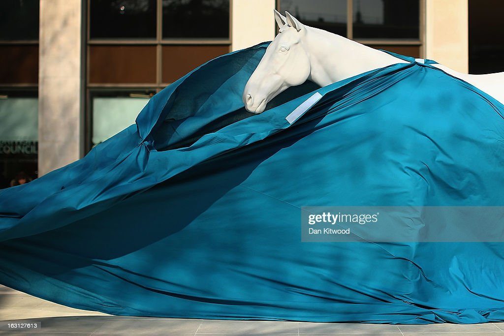 The new sculpture 'The White Horse' by Artist Mark Wallinger is unveiled outside the headquarters of The British Council on the Mall on March 5, 2013 in London, England. The British Council unveiled the marble and resin, life-size sculpture representing a thoroughbred racehorse, as it announced a GBP 7 million investment in work connecting UK-based creative talent overseas.