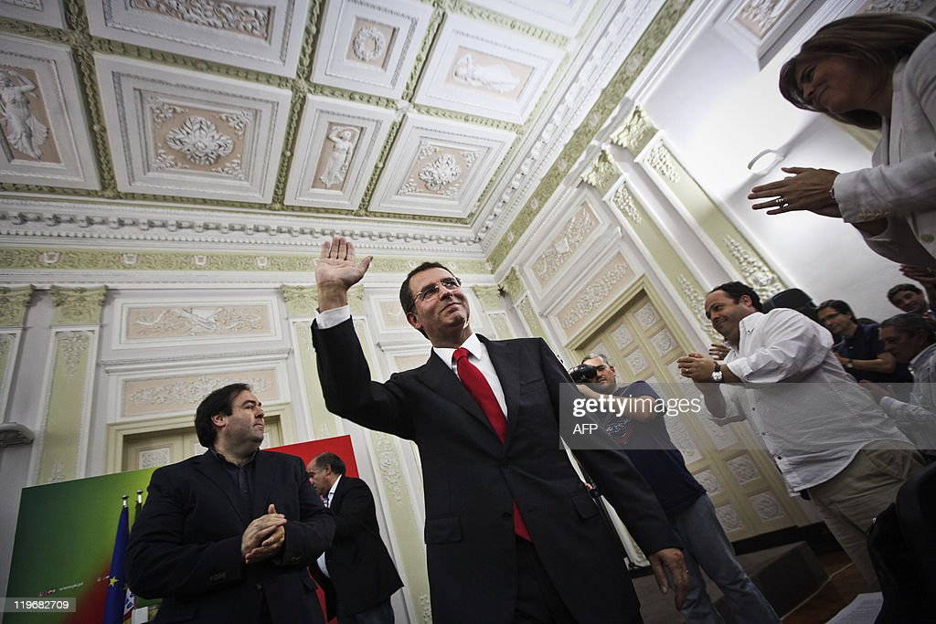 The new secretarygeneral of the Socialist party Jose Antonio Seguro waves to his supporters after winning the elections against his opponent...