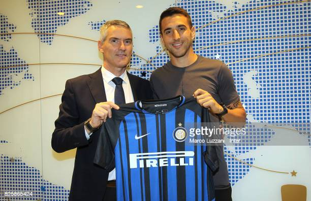 The new signing of FC Internazionale Milano Matias Vecino and CEO of FC Internazionale Alessandro Antonello pose at FC Internazionale headquarters on...