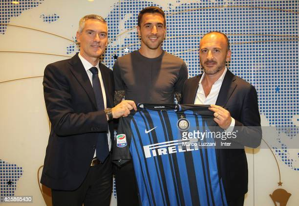 The new signing of FC Internazionale Milano Matias Vecino Sportif Director of FC Internazionale Milano Piero Ausilio and Alessandro Antonello pose at...