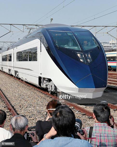 The new sleek style 'Skyliner' highspeed train is unveiled at the Keisei Electric railway's rail yard at Narita city in Chiba prefecture on May 20...