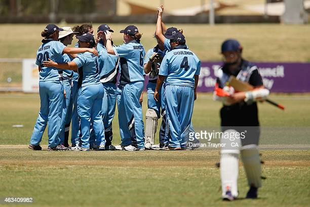 The New South Wales Womens team celebrate a wicket in the final during the 20415 Imparja Cup on February 14 2015 in Alice Springs Australia
