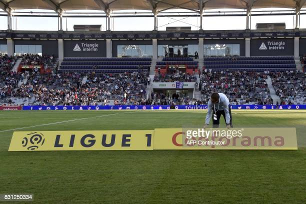 The new sponsor logo 'Ligue 1 Conforama' is installed prior to the French Ligue 1 football match between Toulouse and Montpellier at the Municipal...
