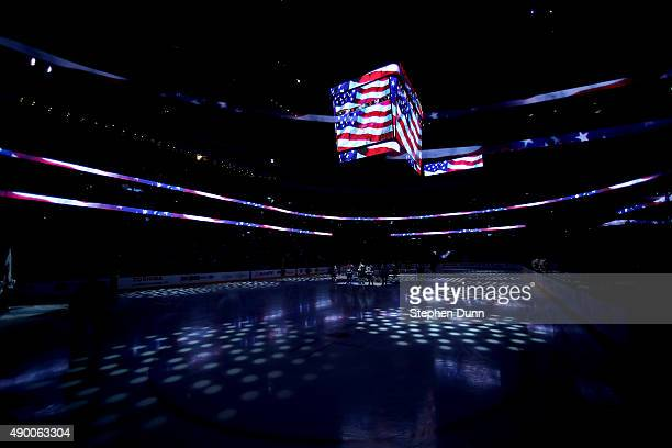 The new stadium scoreboard is light with an American flag during the national anthem before game between the Los Angeles Kings and the Anaheim Ducks...