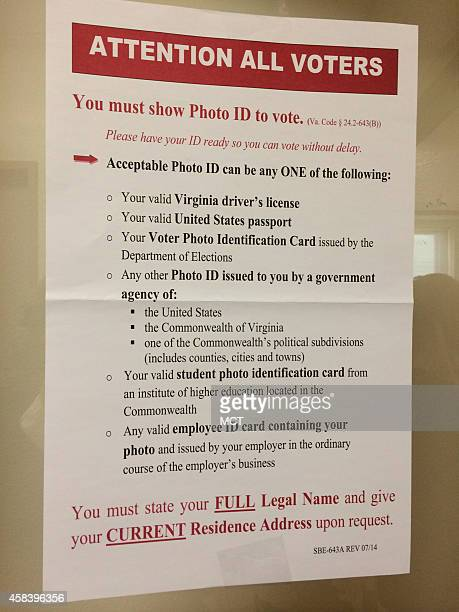 The new state rules are posted prominently at the Lee Center in Alexandria Va where the state began checking photo identification for registered...