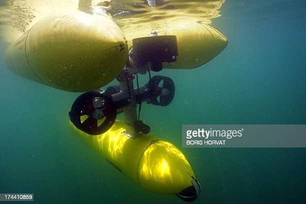 The new submarine robot 'GIRONA500' is submerged on July 25 2013 in La SeynesurMer southern France The Spanish designed robot is part of the European...