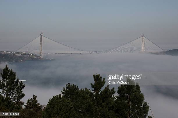 The new third bridge over the Bosphorus Strait connecting Europe and Asia is seen in the final stages of construction amongst heavy fog on February...