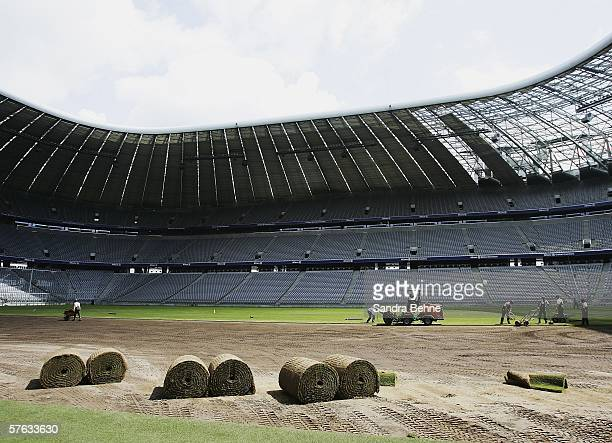 The new turf to be used during the FIFA Football World Cup 2006 is rolled out at the Allianz Arena on May 17 2006 in Munich Germany The stadium will...