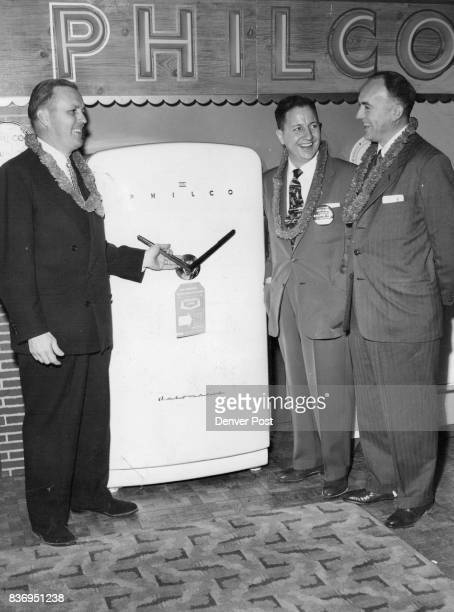 The new twoway door of the Philco 'Golden Automatic' is inspected by Cecil H Boyd president of the Boyd Distributing Co George Daum Philco district...
