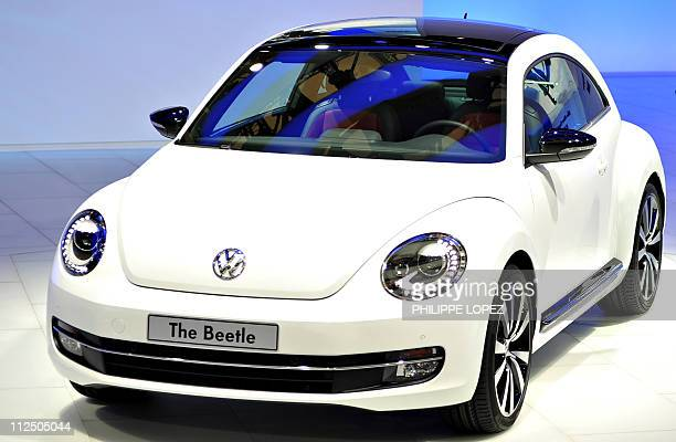The new Volkswagen Beetle is displayed at the Shanghai Auto Show in Shanghai on April 19 2011 About 2000 car and parts makers from 20 countries are...