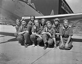 The new WAFS dressed in flying suits and helmets line up in front of the their flight training Aline 'Pat' Rhonie New York City Helen Mary Clarke of...