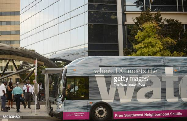 The new Water shuttle bus a new free Southwest Neighborhood Shuttle awaits Mayor Muriel Bowser and other officials at L'Enfant Metro stop for a ride...