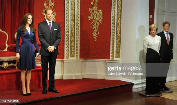 The new wax figures of the Duke and Duchess of Cambridge with Prince William's mother Diana and brother Harry close by go on display at Madame...