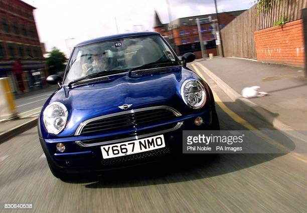 The new Williams BMW Mini drives around the streets of Manchester during the national launch for dealers of the revamped English Classic car 2001 *...