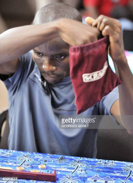 The new world champion Ivorian Elisee Poka takes some letters during the final of the French Scrabble championship against Frenchman Pascal Astresses...
