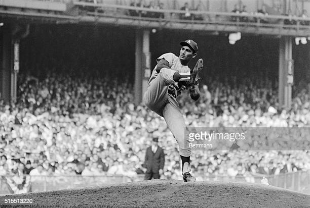 The new World Series strike out king Los Angeles Dodger Sandy Koufax shows the form that helped him fan 15 Yankee batters in first game here 10/2 The...