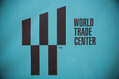The new World Trade Center logo is seen on a fence outside the Ground Zero construction zone on August 14 2014 in New York City The Port Authority of...