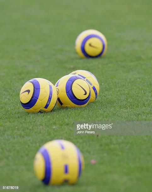 The new yellow Nike balls to be used in matches from now until Spring are seen during a first team training session at Carrington Training Ground on...
