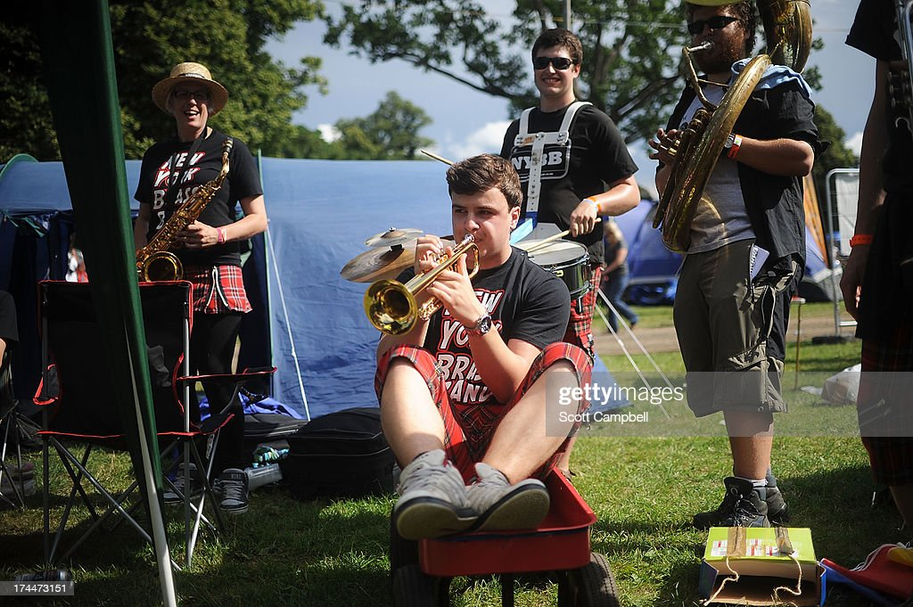 The New York Brass Band performs in the camp site during 80s Rewind Festival at Scone Palace on July 26, 2013 in Perth, Scotland.
