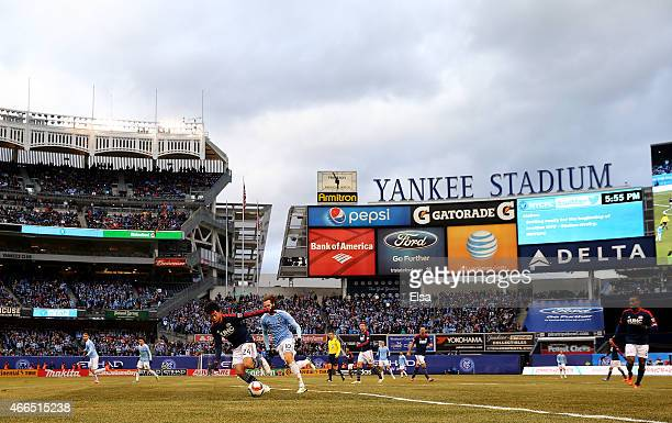 The New York City FC take on the New England Revolution during their inaugural game at Yankee Stadium on March 15 2015 in the Bronx borough of New...